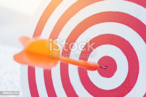 istock Arrows on archery target of dartboard Target business concept 983055752