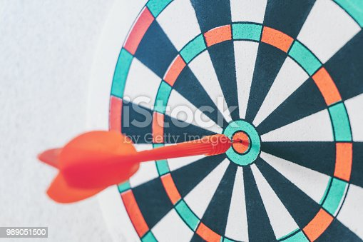 istock Arrows on archery target of dartboard Target business concept 989051500