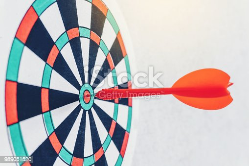 istock Arrows on archery target of dartboard Target business concept 989051520