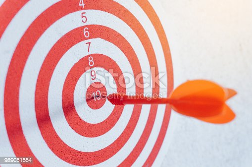 istock Arrows on archery target of dartboard Target business concept 989051554
