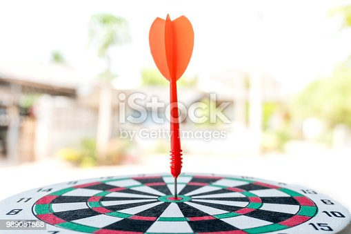 istock Arrows on archery target of dartboard Target business concept 989051568