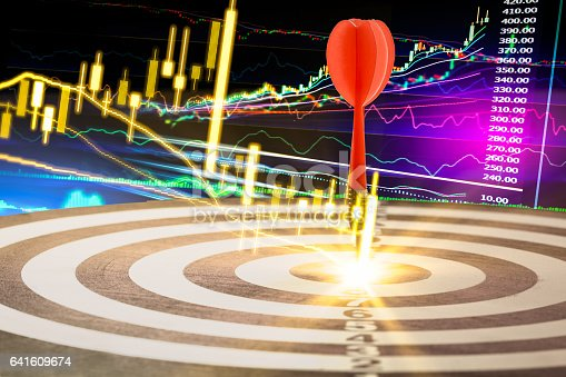 istock Arrows on dart board with stock market graph background mean 641609674