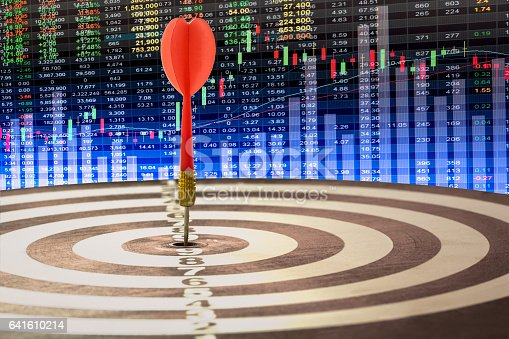 istock Arrows on dart board with stock market graph background mean 641610214