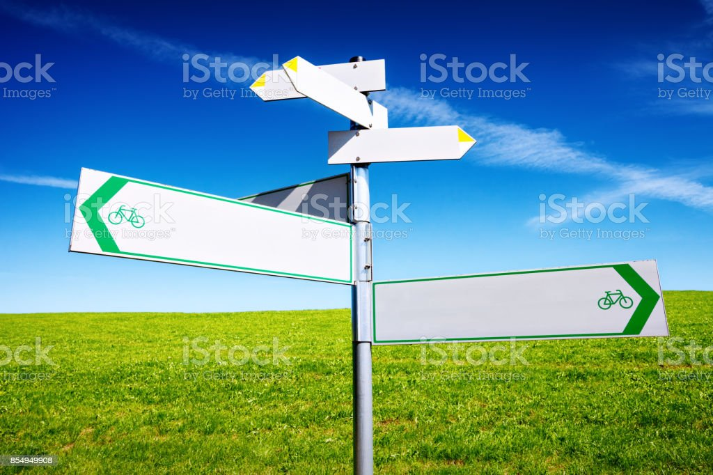 Arrows on signpost in different directions outdoors stock photo