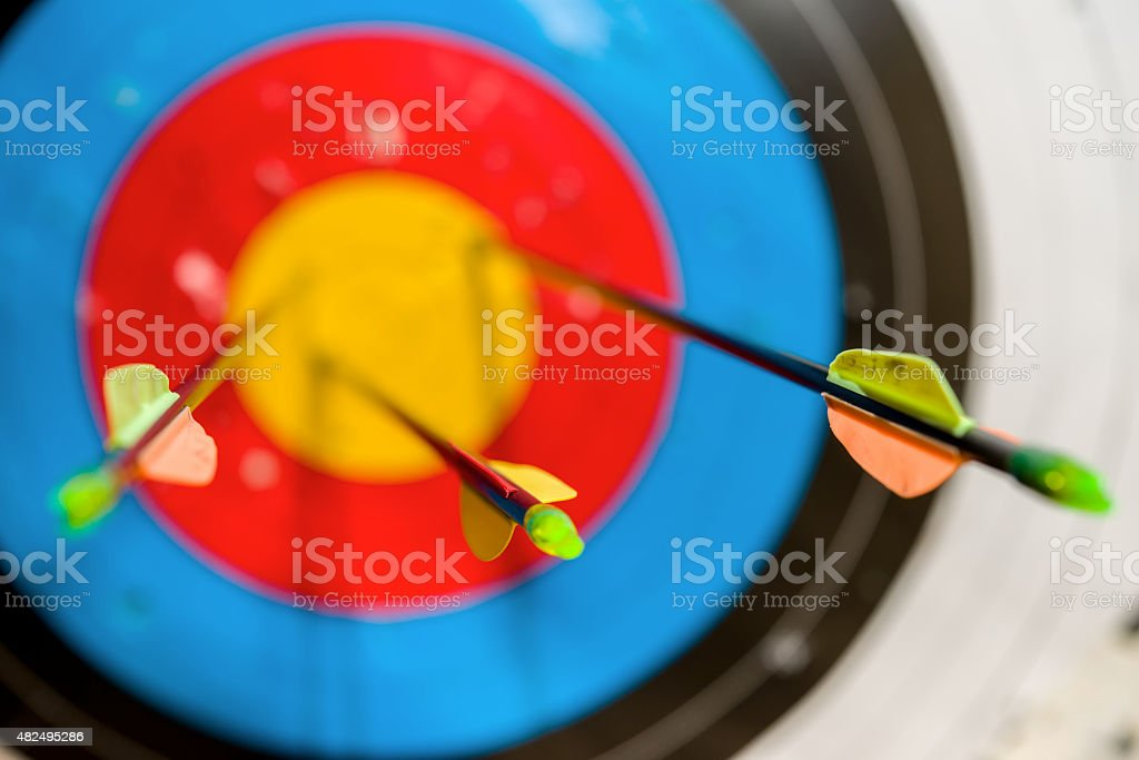 Arrows on the bow hit the target stock photo