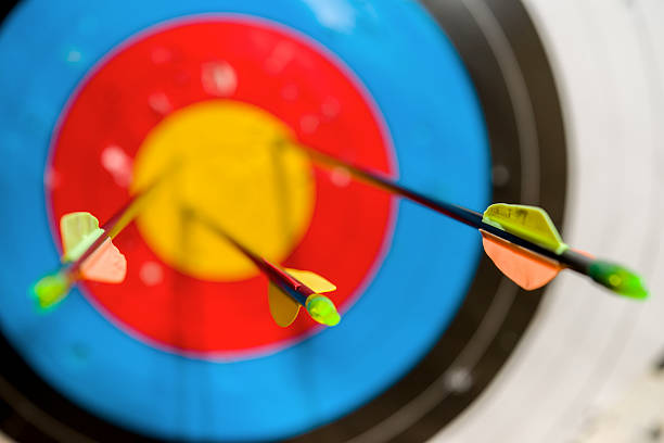 arrows on the bow hit the target - crossbow stock pictures, royalty-free photos & images