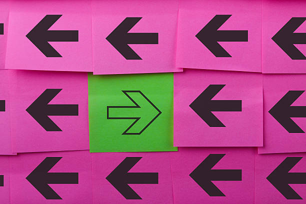 Arrows. Opposing concept. Arrows. Opposite concept. Background of pink sticky notes. bending over backwards stock pictures, royalty-free photos & images