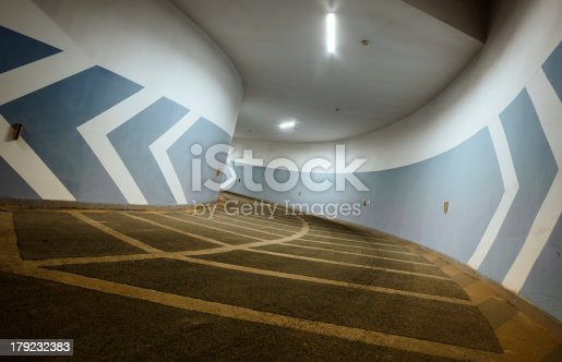 istock Arrows point the way inside of a city parking structure. 179232383