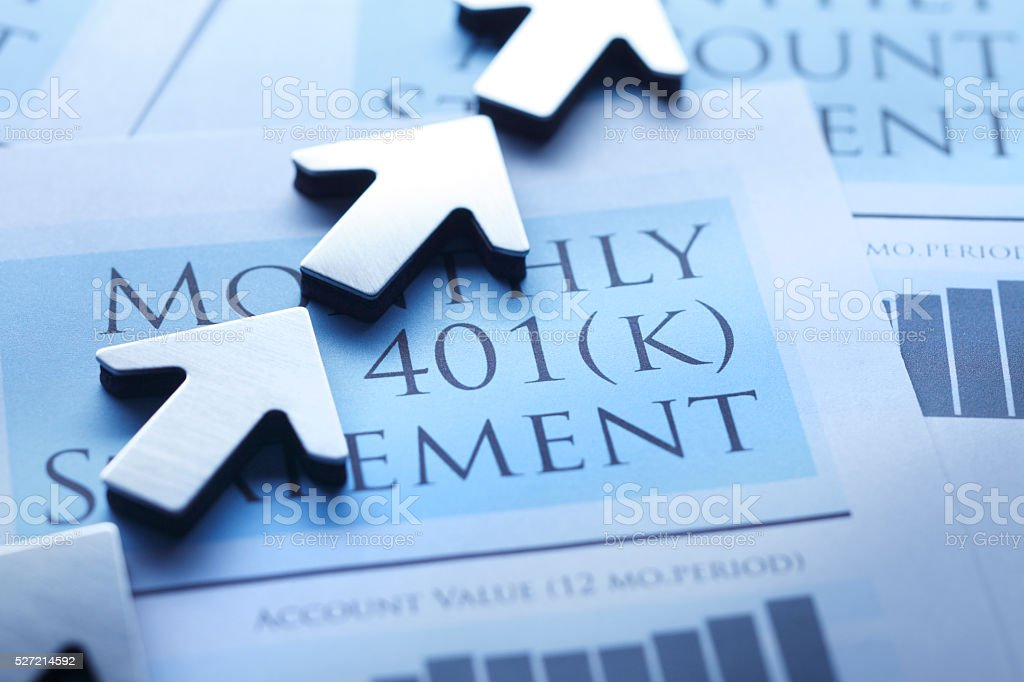 Arrows Pointing In Positive Direction On 401k Statement stock photo
