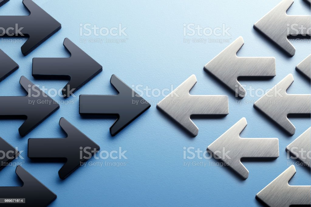 Arrows Pointing Toward A Confrontation stock photo