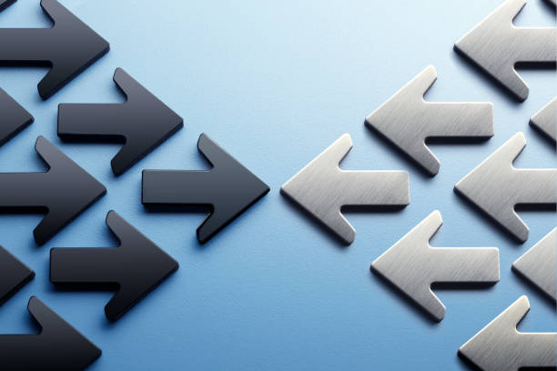 arrows pointing toward a confrontation - defiance stock pictures, royalty-free photos & images