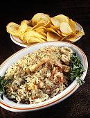 arroz com frutos do mar e batatas chips 1