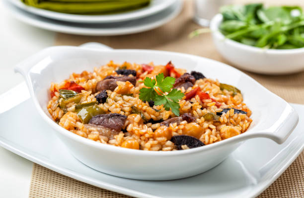 Arroz de pato. Rice with duck meat. Typical dish from Portugal. Arroz de pato. Rice with duck meat. Typical dish from Portugal. arroz stock pictures, royalty-free photos & images