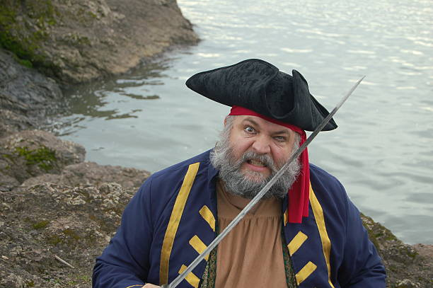 arrrrg, it's a pirate! - swashbuckler stock photos and pictures