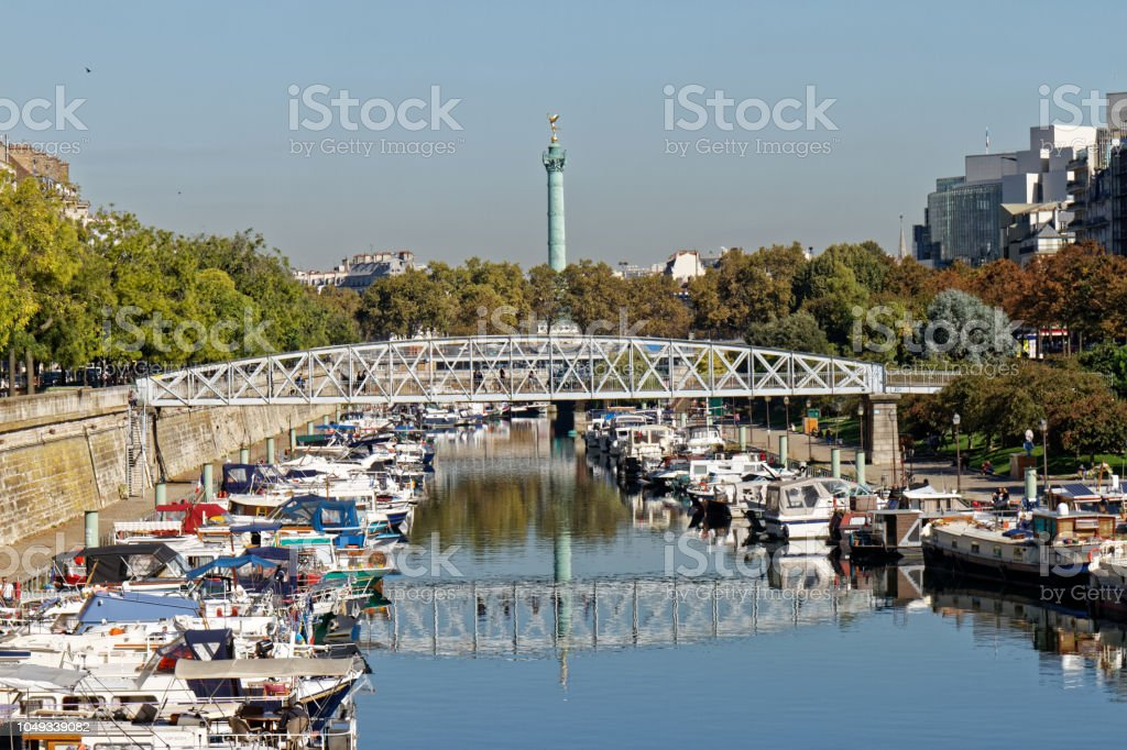 Arsenal harbour and Bastille column - Paris, France stock photo
