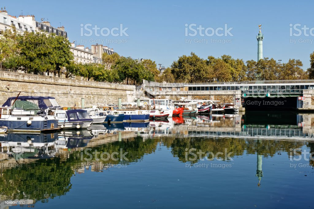 Arsenal harbour and Bastille column. South entrance of Canal Saint-Martin tunnel - Paris, France stock photo