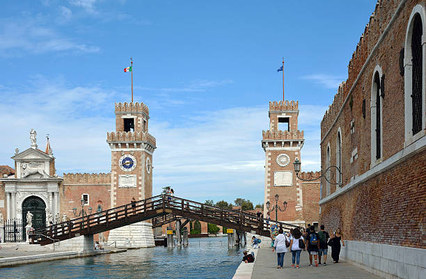 Arsenal of Venice - Italy. Venice, Veneto, Italy - September 5, 2016: Visitors on the way of to historic Venetian Arsenal and Naval Museum in Castello district of Venice in Italy. porta magna stock pictures, royalty-free photos & images