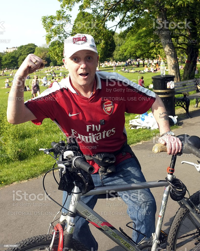 Arsenal supporter with his bike stock photo