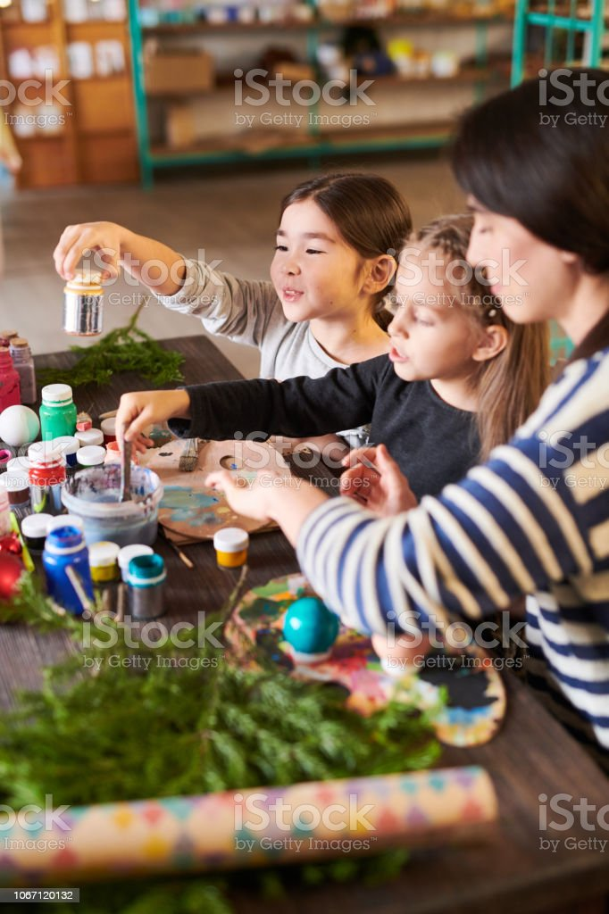 High angle portrait of children making Christmas decorations in...