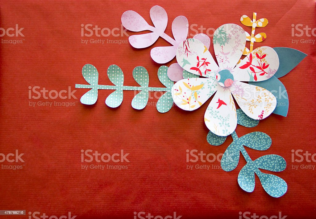 art and craft flower with stem, leaves on red background stock photo