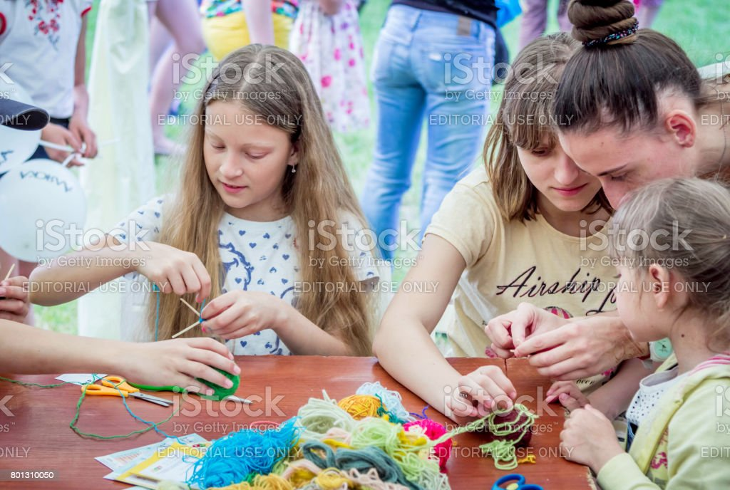 Art and craft - knitting workshop for children stock photo