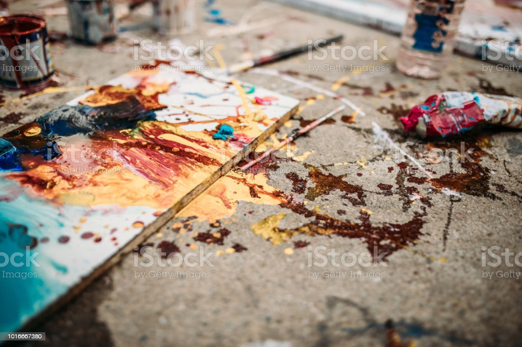 Artistic place of work outdoors with art supplies on the ground