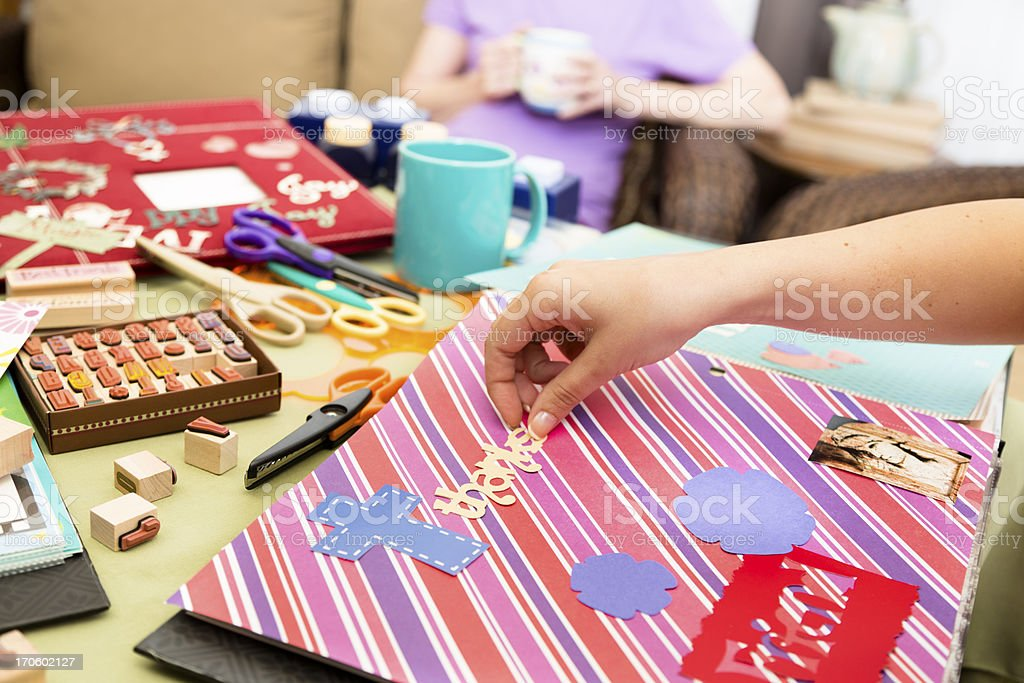 Art and Craft: Scrapbooking with friends.  Sharing coffee while visiting. stock photo