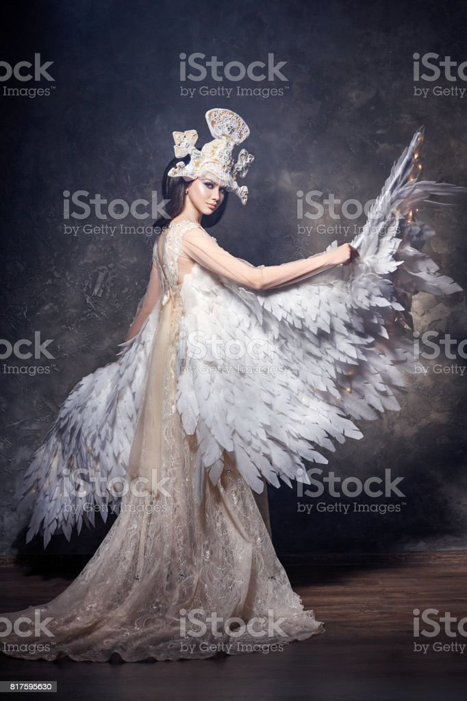 Art angel girl with wings fairy image. Swan Princess, Queen of angels. Lovely dress with wings. Studio beauty portrait stock photo