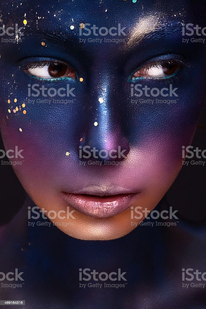 art beautiful girl with color paint on her face stock photo