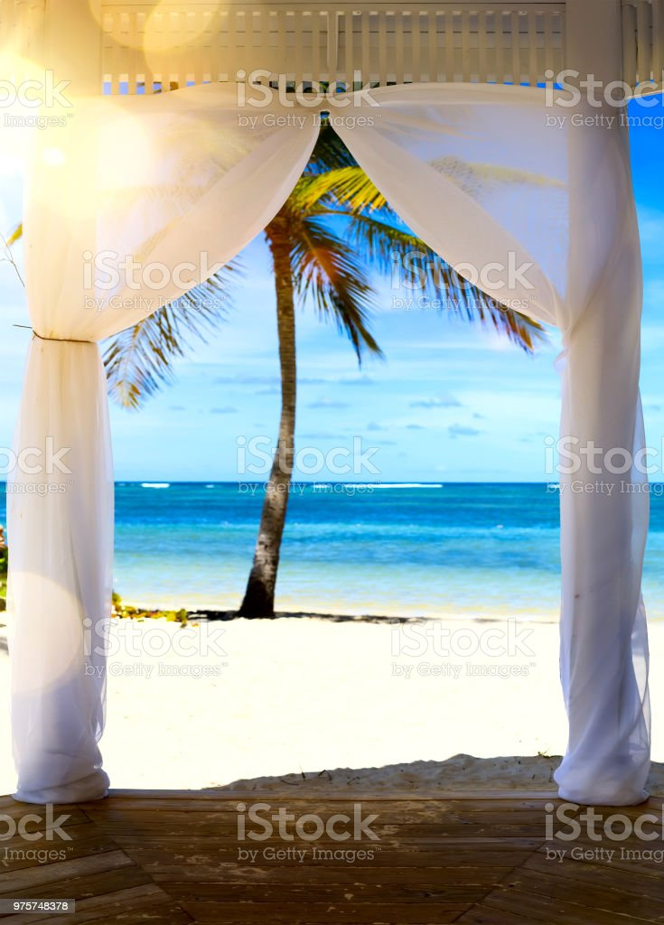Art Beautiful sunrise over the tropical beach; wedding ceremony marquee. stock photo