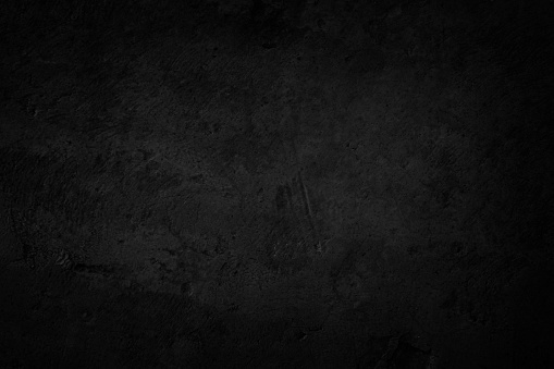 Art black concrete stone texture for background in black. Abstract color scratches shabby vintage Cement and sand grey dark detail covering.