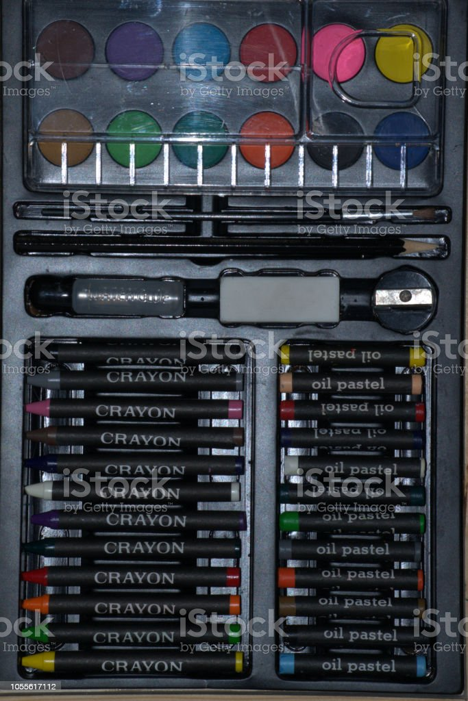 Image of a box of artisit\'s material including crayons, oil pastels,...