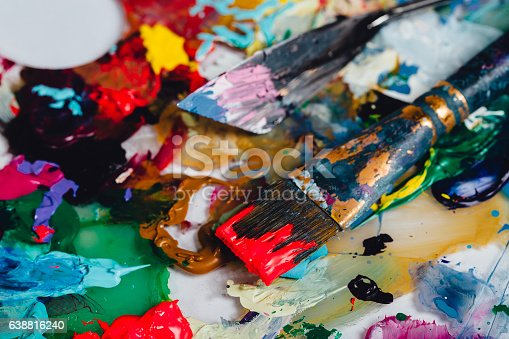 istock Art brush mixed paint on the palette. Tools of the 638816240
