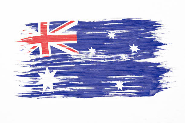 Art brush watercolor painting of Australian flag blown in the wind isolated on white background. stock photo