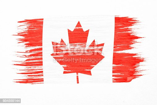 istock Art brush watercolor painting of Canadian flag blown in the wind isolated on white background. 934555144
