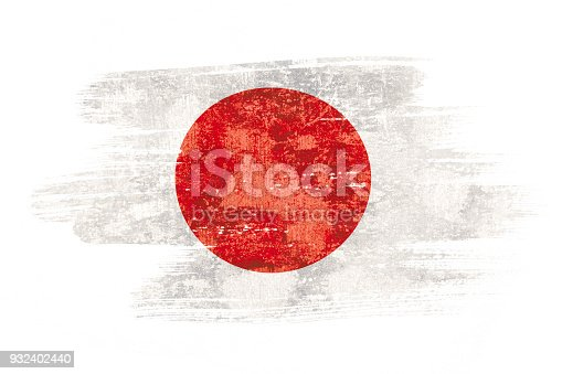 istock Art brush watercolor painting of Japan flag blown in the wind isolated on white background. 932402440