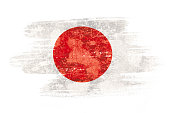 Art brush watercolor painting of Japan flag blown in the wind isolated on white background.