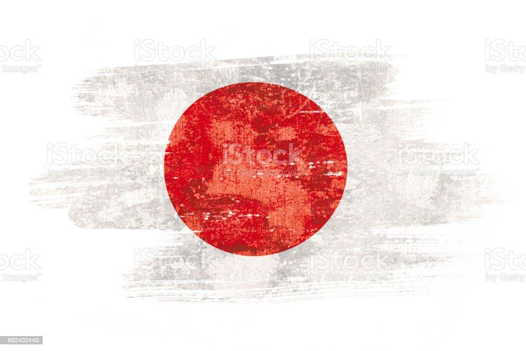 Arte pincel aquarela pintura da bandeira do Japão soprada ao vento isolado no fundo branco. - foto de acervo