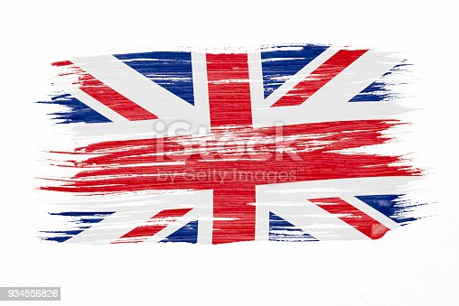 istock Art brush watercolor painting of UK flag blown in the wind isolated on white background. 934556826