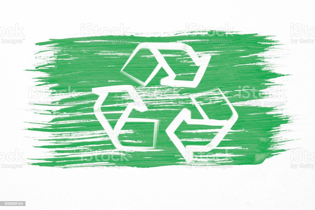 Art brush watercolor painting of white Recycle logo symbol or recycling arrows on green flag blown in the wind isolated on white background. stock photo