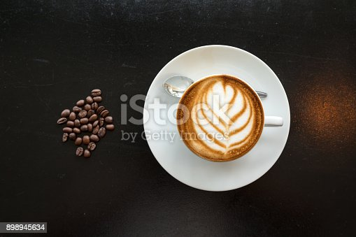 istock Art coffee latte placing with coffee bean by flat lay 898945634