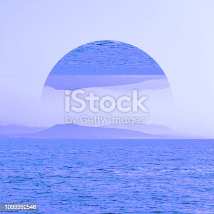 Aesthetic art collage with awesome view of nature with mountains and sea in  inversion blue colours and mirror reflection in circle frame.