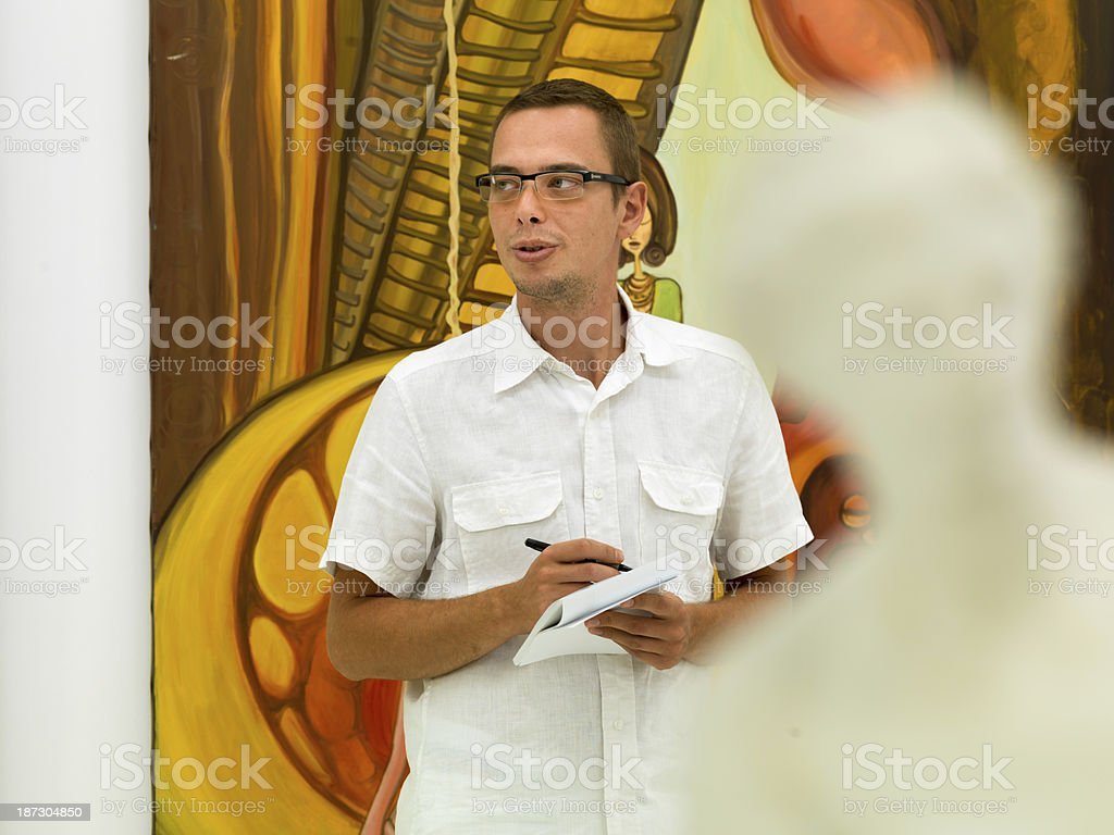 art collector at exhibition opening stock photo