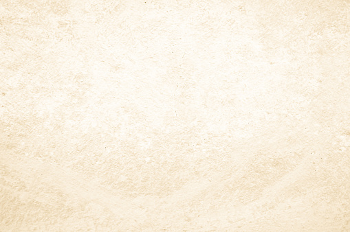 Art concrete or stone texture for background in black, brown and cream colors. Cement and sand wall of tone vintage.
