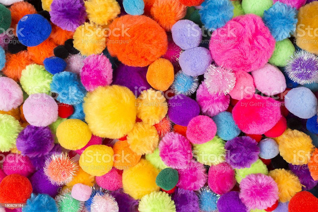 Art Craft Backgrounds: Assortment of pompom colors and sizes. royalty-free stock photo