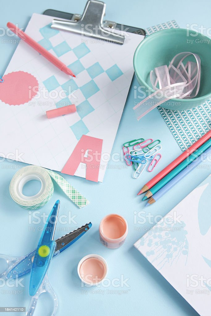 Art craft supplies on blue, green and coral on blue background royalty-free stock photo