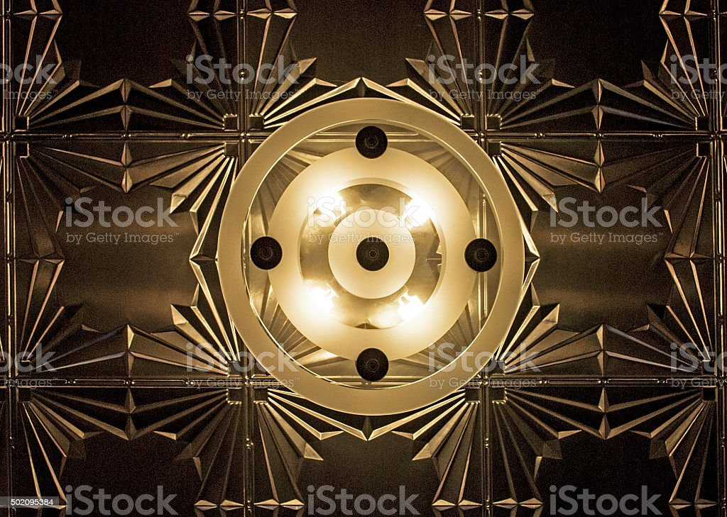Art Deco Ceiling Light Centered in Frame with Tin Ceiling bildbanksfoto