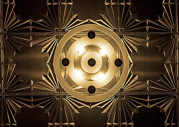 Art Deco Ceiling Light Centered in Frame with Tin Ceiling stock photo