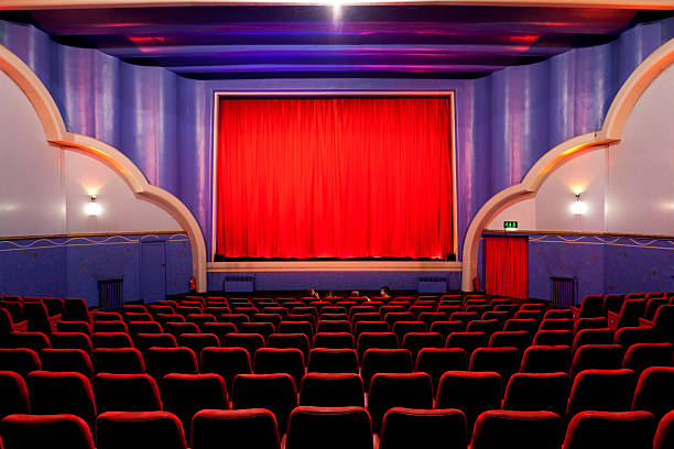art deco cinema - row of heads stock photos and pictures