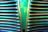 Detail of the Art Deco radiator grille of a vintage American car.